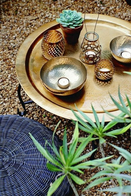 fast-decode-garden-ideas-round-brass-occasional-tables-shell-lanterns-succulent-rattan-poufs