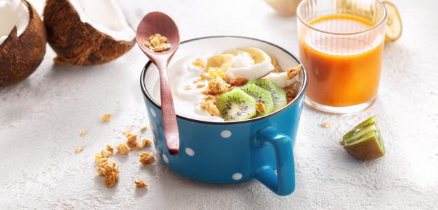 probiotic-food-concept-bowl-homemade-coconut-yogurt-with-granola-fruits-healthy-vegan-food-tasty-healthy-breakfast_118925-2228